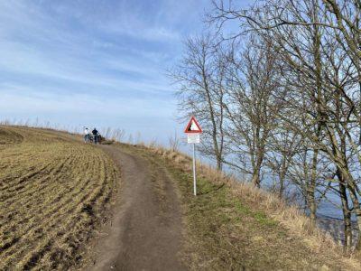 Hinweisschild Steilküste Dänisch-Nienhof Abbruchkante